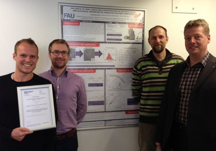 The authors and the winning poster on properties of conductive polymer composites
