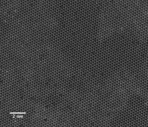 This image from a scanning transmission electron microscope shows the individual atoms in a two-dimensional sheet of molybdenum diselenide. Source: E. Ringe/Rice University..