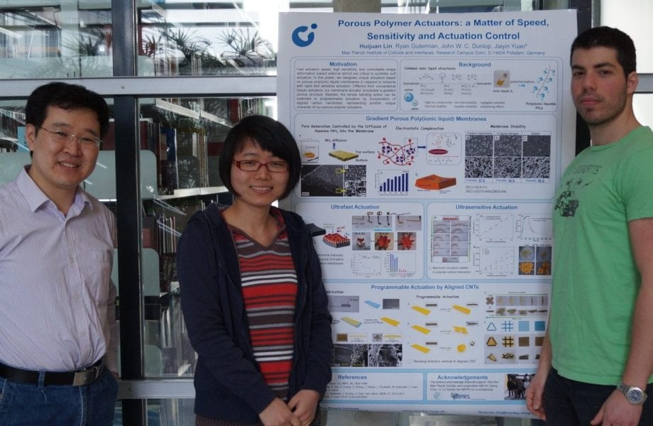 Jiayin Yuan, Huijuan Lin, Ryan Guterman (left to right) and the winning poster on porous polymer actuators