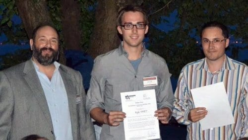 Kyle Hart (middle) and co-authors of the winning poster on sulphur-containing polymers of intrinsic microporosity