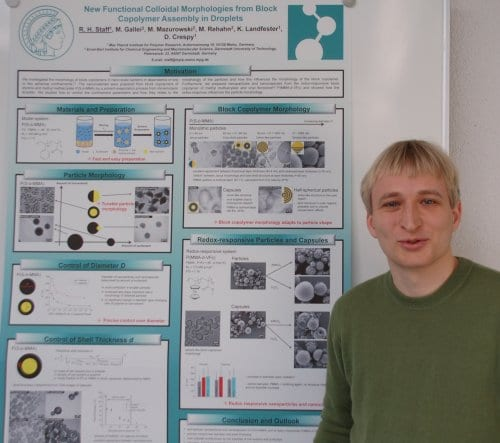 Roland Staff and the winning poster on functional colloidal morphologies