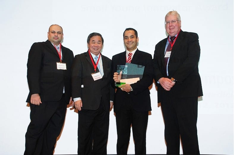The prize winners, Professor Khademhosseini (centre right) and Professor Zhang (centre right) with journal editors Dr. Jose Oliveira and Dr. Peter Gregory.