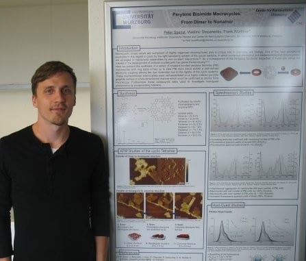 Peter Spenst and the winning poster on perylene bisimide macrocycles