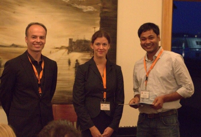 Prize winner Chandan Maity (right) together with conference organizer Hans Börner (left) and journal editor Anne Pfisterer (middle)