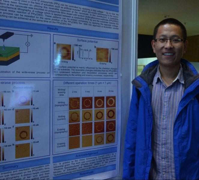 He Liu and the winning poster on electrochemical patterning of polypyrrole films