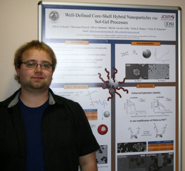 Oliver Eckardt and the winning poster on core-shell hybrid nanoparticles