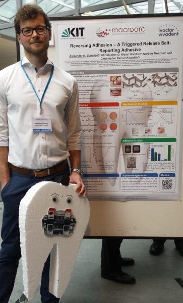 Alexander Schenzel and the winning poster on a self-reporting adhesive
