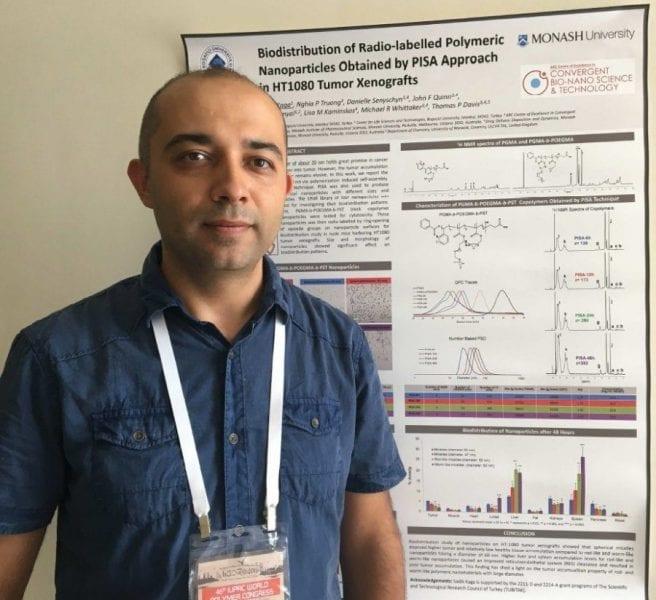 Sadik Kaga and the winning poster on macromolecules in biotechnology & medicine